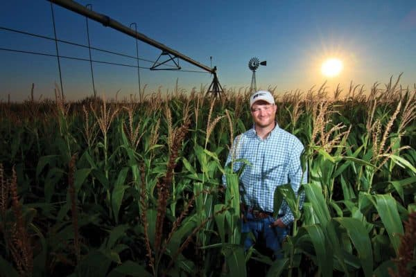 okfb farmer standing in corn field