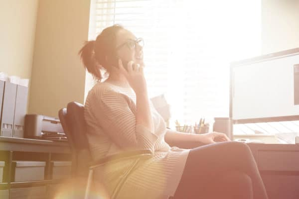 woman on the phone sitting in home office