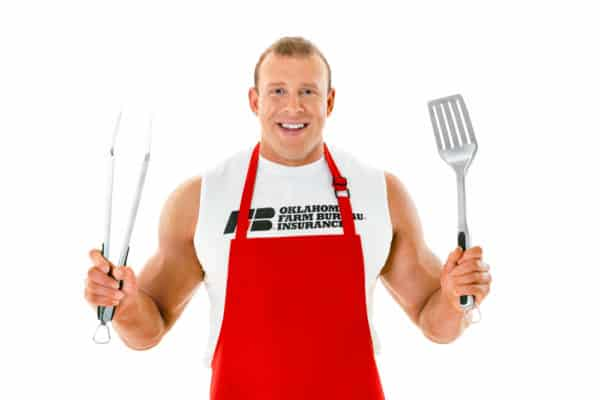 Image of Huge holding spatula to grill burgers