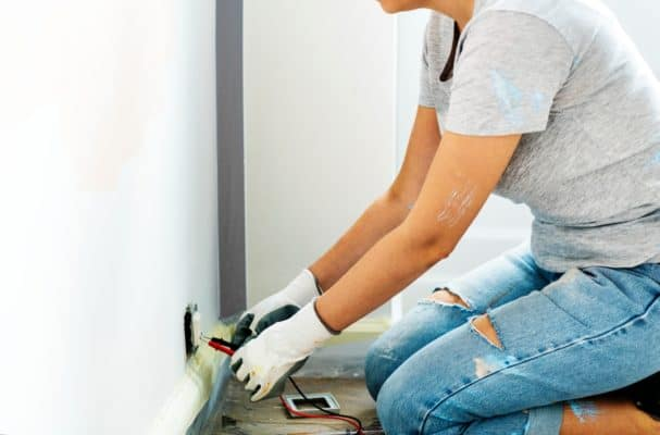 Electrician repairing a home outlet