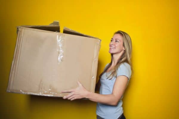 Woman holding cardboard box for moving