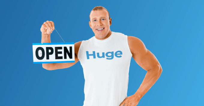 Huge holding an open for business sign