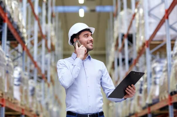 Business owner conducts inventory check in warehouse