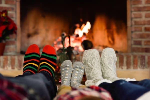 warming feet near a fireplace to stay warm