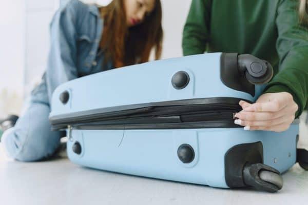 closing a stuffed suitcase