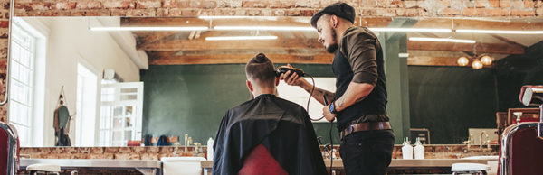 Barber giving a haircut to a client