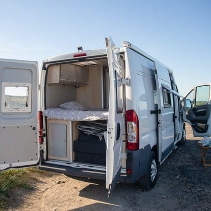 motorhome back doors open showing bed
