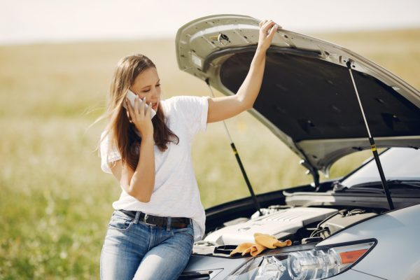 Woman on the phone after getting in a car accident
