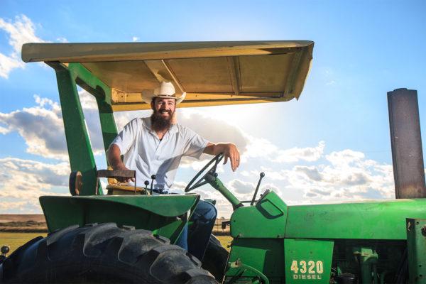 farmer sitting on a tractor