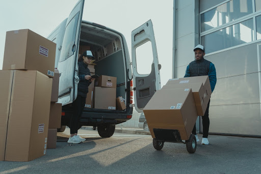 employees unloading boxes from company van
